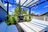 foto of pergola  - Cozy paito area with two couches table and fireplace - JPG