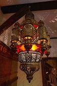 Moroccan Lantern Lamp Illuminating Patterns Of Light On The Wall