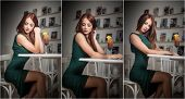 stock photo of redhead  - Fashionable attractive young woman in green dress sitting in restaurant - JPG