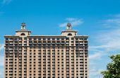 Many Windows On A Massive Stone Hotel Under Blue Sky