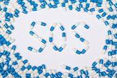 Sos Word Text Made Of Blue Tablets, Pills And Capsules