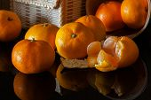 many beautiful orange tangerine on the table