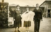 GERMANY, AUGUST 19, 1941: Vintage photo of parents and grandmother with their child after baptising