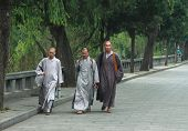 Three shaolin monks go somewhere
