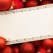 Christmas card with decoration on red background.