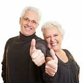 Senior Citizens Holding Thumbs Up