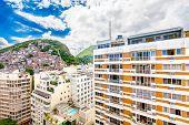 Favela, Brazilian Slum On A Hill Behind A Residential Area In Rio De Janeiro