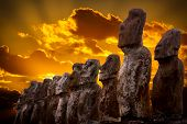 Standing Moais With Orange Clouds In Background In Easter Island, Chile