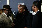 NEW YORK-DEC 3: (L-R) Comedian/actors Cedric the Entertainer (L), Chris Rock (R) and rapper Kanye West attend the