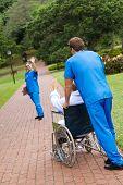 nurse waving goodbye to patient