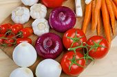 Fresh ripe vegetables on a wooden board