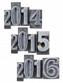passing and incoming years 2014, 2015, 2016 - isolated numbers in vintage metal printing blocks
