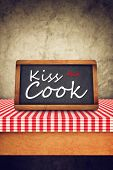 Kiss The Cook Title On Restaurant Slate Chalkboard