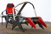 Professional ice climbing crampons close up image