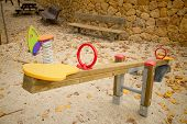 image of seesaw  - Seesaw in a playground with scattered autumn leaves - JPG