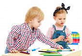 stock photo of montessori school  - boy and girl draws felt - JPG
