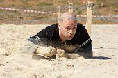 Man Crawling On Sand