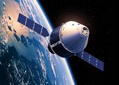 stock photo of ares  - Crew Exploration Vehicle Orbiting Earth - JPG
