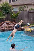 Teen boys swimming