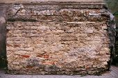 fragment of brick pilaster with plaster
