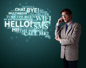 Young man in suit making phone call with word cloud