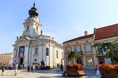 Tourists visit the city center of Wadowice