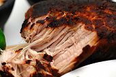 stock photo of roasted pork  - A browned pork roast pulled apart cooked in the Mexican style for the dish known as carnitas - JPG