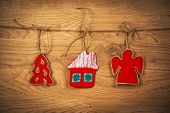 Christmas house on wooden background