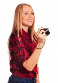 Glamour female photographer holding a compact camera - isolated