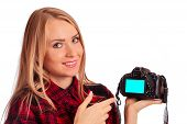 Attractive female photographer showing screen of camera  - isola