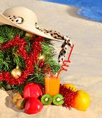 Christmas Tree With Woman Beach Hat, Fresh Juice And Ripe Fruits On Sand On Beach