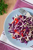 Salad of red and white cabbage and sweet red pepper, seasoned with lemon juice and olive oil