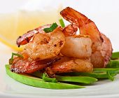 Shrimp sauteed with garlic and soy sauce on a cushion of avocado slices