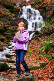 image of grils  - Little artist gril with sketch in note at autumn landscape - JPG