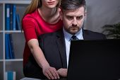 picture of inappropriate  - Handsome man working after hours with his young pretty secretary - JPG