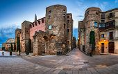 picture of gate  - Panorama of Wall and Gate of Roman City Barcino and Placa Nova in the Morning Barcelona Catalonia - JPG