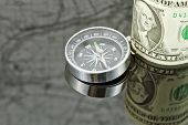 image of reflection  - dollar bill and compass are on the surface which reflects map - JPG