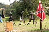 pic of civil war flags  - Three sets of stacked arms at a Civil War reenactment - JPG