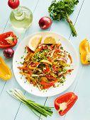 stock photo of vinegar  - Spring salad with bell pepper spanish onion leek and blackberry vinegar - JPG