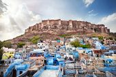 picture of rajasthani  - Blue city and Mehrangarh fort on the hill at sunset sky in Jodhpur Rajasthan India - JPG