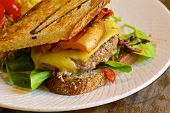 picture of beef-burger  - Delitious homemade cheeseburger with a fresh lettuce - JPG