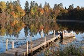 image of dock a lake  - boat and dock in the fall colors at the lake - JPG