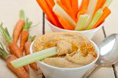 stock photo of carrot  - fresh hummus dip with raw carrot and celery arab middle eastent healthy food - JPG