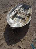 picture of sloop  - Weathered boat upon beach photographed at Exmouth in Devon - JPG