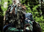 stock photo of camouflage  - the airsoft recon with masked camouflage woodland