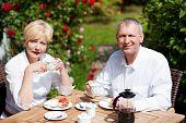 Mature couple having coffee on porch