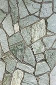 stock photo of tile cladding  - section of flagstone wall with varying shapes and lines - JPG