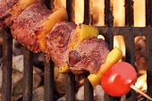 stock photo of bbq party  - Weekend BBQ Meat Beef Kebab Or Kabob On The Hot Flaming Grill - JPG