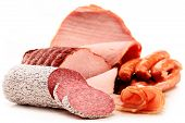 picture of slaughterhouse  - Assorted meat products including ham and sausages isolated on white - JPG