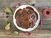 pic of cake-ball  - Christmas pear ginger and honey cake with creamy caramel topping fresh pears and Christmas decoration balls over a rustic wooden background - JPG